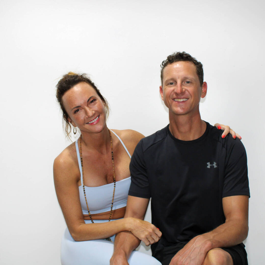 couple photo of founder and her husband in yoga gear hugging